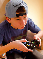 Teenage Boy playing Xbox 360 Video Game - Feb 2013.