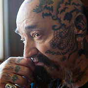 "Rescue Ink, Long Island, New York, taettowierte Motoradgang, Verein zur Rettung mishandelter Hunde und anderer Tierarten.'Batzo""..Rescue Ink, the animal rescue group that brings an in your face approach to the fight against animal abuse and neglect. The goups members are heavily tattooed and ride motorbikes. Their pitbull 'Rebel', who lives at their headquarters, was rescued from a dog fighting operation, where he was used as bait. He was near death when two members of Rescue Ink flew to Virginia to save him...Foto © Stefan Falke."