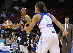 June 3, 2012; Newark, NJ, USA; Indiana Fever guard Briann January (20) dribbles the ball while being defended by New York Liberty guard Leilani Mitchell (5) during the second half at the Prudential Center. The Liberty defeated the Fever 87-72.