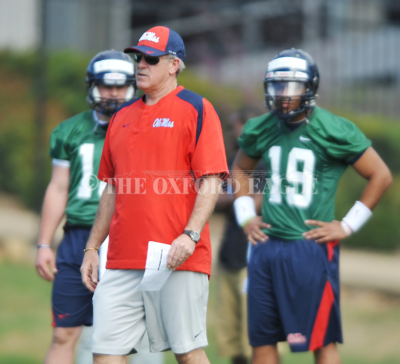 Offensive coordinator Dan Werner watches a play as Mississippi began spring practice in Oxford, Miss. on Friday, March 23, 2012. (AP Photo/Oxford Eagle, Bruce Newman)