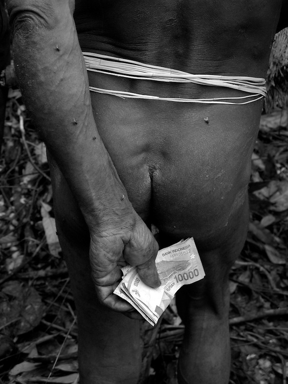 indonesian money is creeping in to the kombai way of life, they will trade for traditional stone axes and other traditional kombai posessions with the few westerners they will see each year, but then must walk for at least 5 days to Yaniruma to be able to spend it.