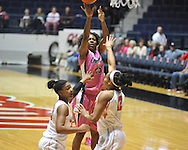 "Ole Miss' Courtney Marbra (25) vs. Georgia's Jasmine Hassell (12) and Shacobia Barbee (20) in women's basketball at the C.M. ""Tad"" Smith Coliseum in Oxford, Miss. on Sunday, February 24, 2013. Georgia won 73-54."