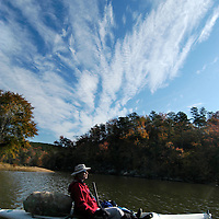 Paddling on Cedar Creek Reservoir, Catawba River at Great Falls, SC. Land around lake protected by Katawba Valley Land Trust forever