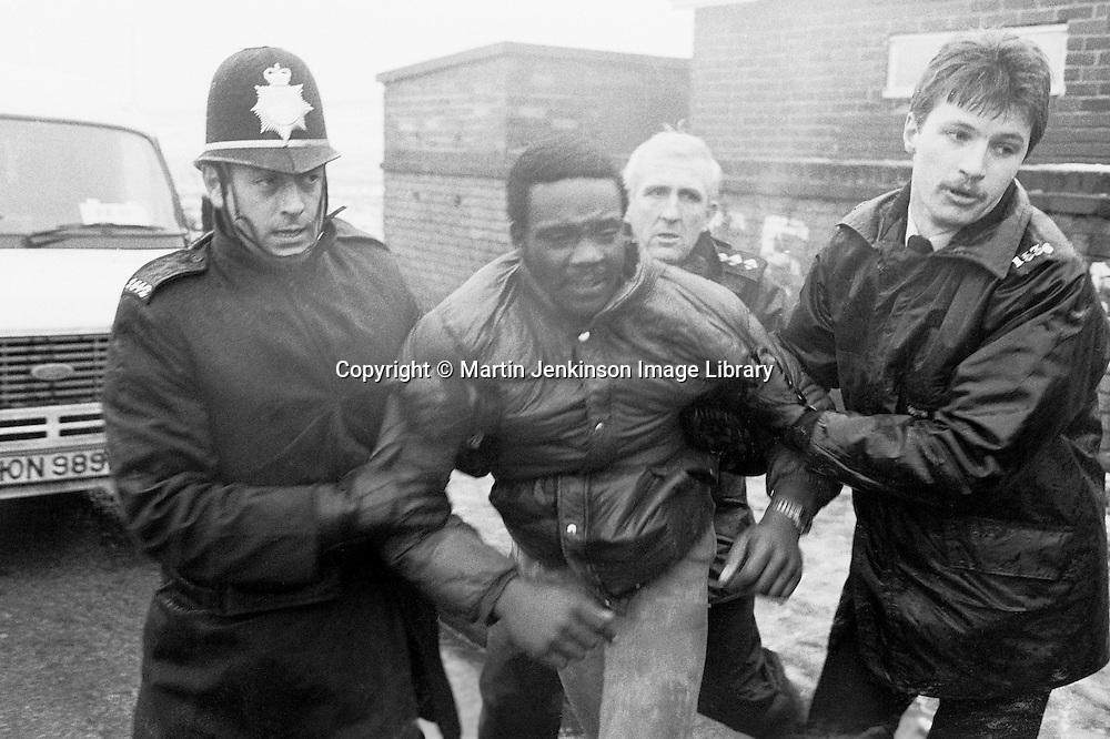 Police arrest a miners picket at Hatfield Main Colliery during the 1984 1985 miners strike. January 1985...&copy; Martin Jenkinson<br /> email martin@pressphotos.co.uk  NUJ recommended terms &amp; conditions apply. Copyright Designs &amp; Patents Act 1988. Moral rights asserted credit required. No part of this photo to be stored, reproduced, manipulated or transmitted by any means without prior written permission.