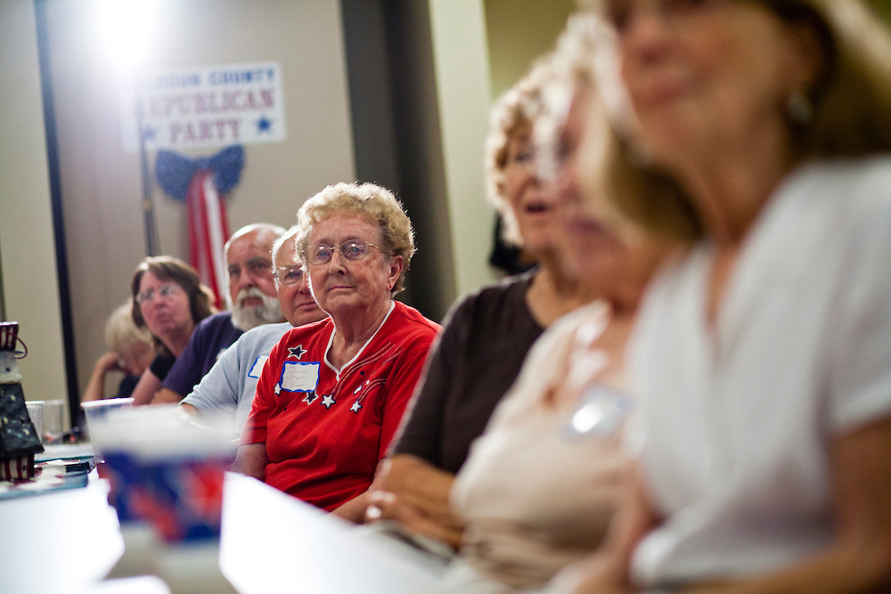 Attendees at a Calhoun County Republican Party dinner listen to Republican presidential candidate Rep. Michele Bachmann (R-MN) during a campaign stop on Monday, August 8, 2011 in Rockwell City, IA.