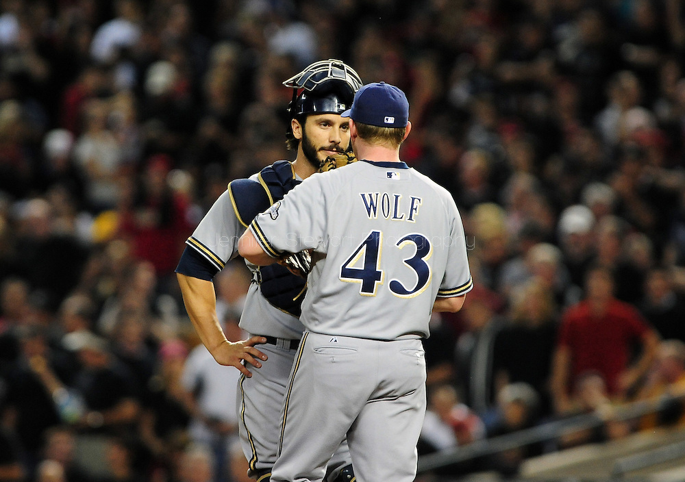 Oct. 5 2011; Phoenix, AZ, USA; Milwaukee Brewers pitcher Randy Wolf (43) talks with catcher George Kottaras (16) during the first inning against the Arizona Diamondbacks at game four of the 2011 NLDS at Chase Field.  Mandatory Credit: Jennifer Stewart-US PRESSWIRE..