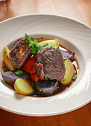 Boneless beef short ribs braised in Cabernet Sauvignon. Sauce is pan drippings with veal stock reduction. Served with roasted vegetable mire poix, baby potatoes.