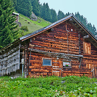 Golzern, Switzerland - full view of traditional wooden barn with hayricks on the side.