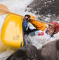 Clark Fletcher of Fort Dodge, Iowa races in the OC1 men's plastic during the slalom course of the 42nd Annual Missouri Whitewater Championships. Fletcher overturned and did not finish his run. The Missouri Whitewater Championships, held on the St. Francis River at the Millstream Gardens Conservation Area, is the oldest regional slalom race in the United States.
