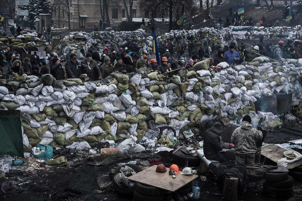 Anti government protesters stand guard on Hrushevskoho street barricades near Maidan Square during standoff with riot police while a truce was agreed, in Kiev, 28 January 2014.