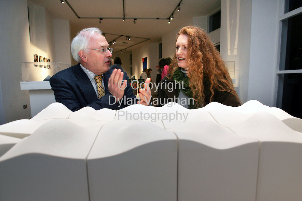 "2/12/2005.Pictured at the opening of the Craftmark 'Piece"" exhibition at the Craft Council of Irelands National Craft Gallery in Kilkenny was from left Martin Walsh Chairman of the Crafts Council of Ireland and Frances Lambe  from Dundalk County Louth. Martin and Frances are pictured with work by Frances called "" Slab""..Picture Dylan Vaughan.."