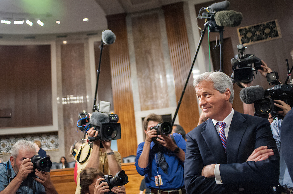 James Dimon, chairman of the board, president and CEO of JPMorgan Chase & Co., testifies before the Senate Banking, Housing and Urban Affairs Committee to explain a $2 billion trading loss in early May.