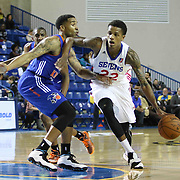 Delaware 87ers Guard Jamal Jones (22) drives past Westchester Knicks Guard Markeith Cummings (14) defends in the first half of a NBA D-league regular season basketball game between the Delaware 87ers and the Westchester Knicks (New York Knicks) Sunday, Dec. 28, 2014 at The Bob Carpenter Sports Convocation Center in Newark, DEL