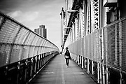 A young boy walks on the Manhattan bridge, New York, 2010.