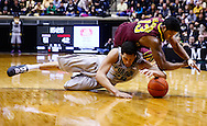 WEST LAFAYETTE, IN - MARCH 09: A.J. Hammons #20 of the Purdue Boilermakers and Maverick Ahanmisi #13 of the Minnesota Golden Gophers battle for a loose ball at Mackey Arena on March 9, 2013 in West Lafayette, Indiana.  (Photo by Michael Hickey/Getty Images) *** Local Caption *** A.J. Hammons; Maverick Ahanmisi