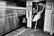 Classic ballerina with tutu dancing in the New York Subway. Dancer: Andrea Wolf.