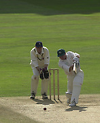 Photo Peter Spurrier.01/09/2002.Village Cricket Final - Lords.Elvaston C.C. vs Shipton-Under-Wychwood C.C..Shipton's Phil Garner drives the ball through the offside, Elveston keeper Lee Archer.