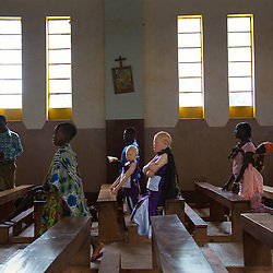 Residents of the Kabanga Protectorate Center and School in Tanzania attend a local Sunday church service. Residents with albinism make up roughly one-third of the center's population—and 60 percent of them are children.