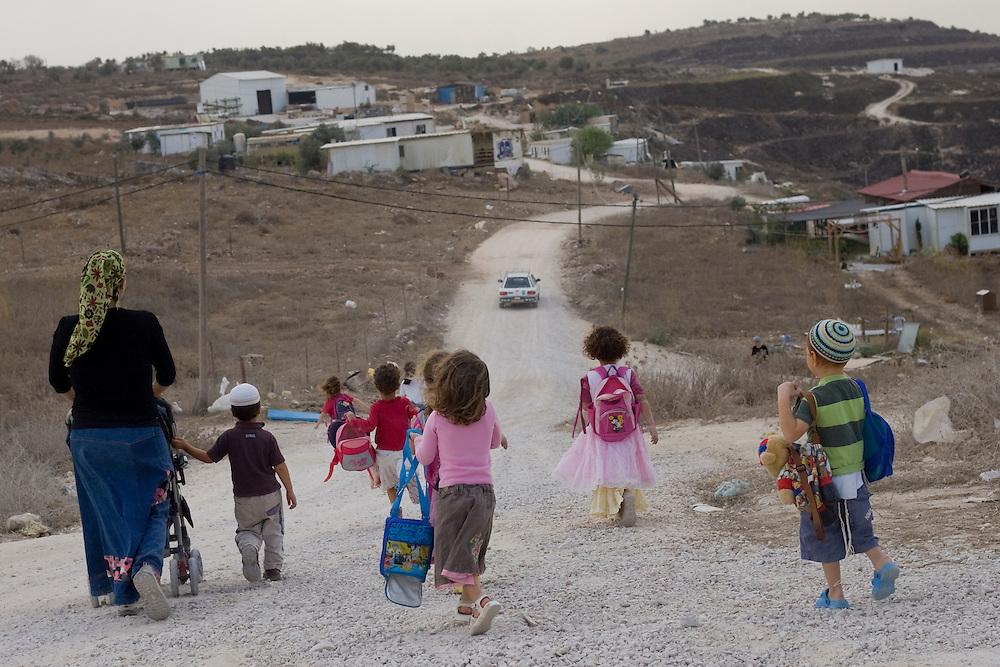 Israeli settler children make their way back home from the kindergarten in Havat Gilad.