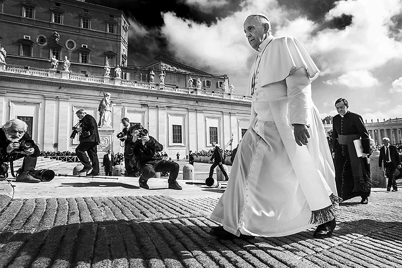 """Pope Francis walks past photographers during his general weekly audience in St. Peter's Square at the Vatican. Pope Francis appealed for equal pay for equal work today, calling compensation disparity a """"pure scandal""""."""
