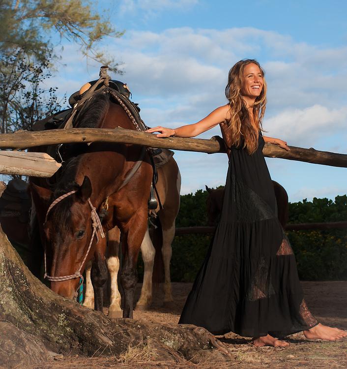 Woman with horse in Tiare Hawaii Lanai Dress in Black<br /> www.tiarehawaii.com<br /> Model: Andrea Hannemann