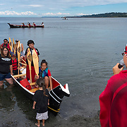 Paddlers in the native Canoe Journey are welcomed to Port Angeles' beach by the Lower Elwha Tribe. 78 canoes participated, joining each other as tribes entered the route along the way, and included representatives from tribes as far away as Montana and even New Zealand.<br />
