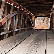 A Burr Arch Truss supports McAllister Covered Bridge (126 feet long), built in 1914 by J.A. Britton over Little Raccoon Creek, on County Road 400S, Parke County, Indiana, USA.