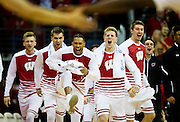 The University of Wisconsin bench erupts after a second half basket during the University of Minnesota Men's Basketball game versus University of Wisconsin on March 5, 2017.