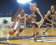 "Mississippi's Kayla Melson (20) drives past Vanderbilt's Hannah Tuomi (15) at the C.M. ""Tad"" Smith Coliseum in Oxford, Miss. on Sunday, January 2, 2011. (AP Photo/Oxford Eagle, Bruce Newman)"