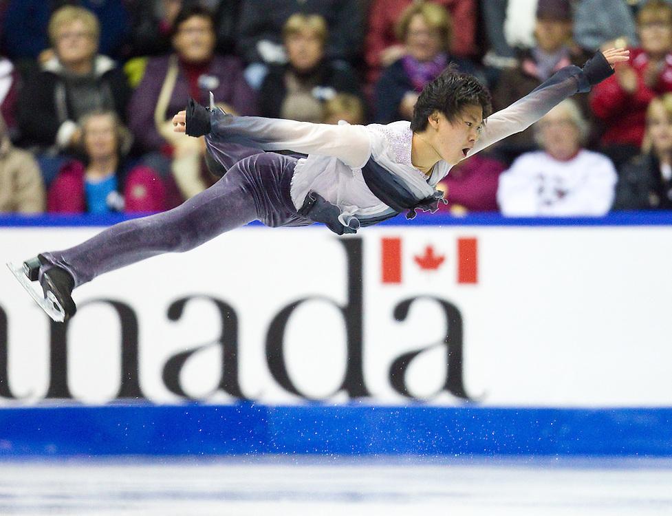 GJR347 -20111028- Mississauga, Ontario,Canada-  Denis Ten of Kazakhstanakhstan skates his short program at Skate Canada International, October 28, 2011.<br /> AFP PHOTO/Geoff Robins