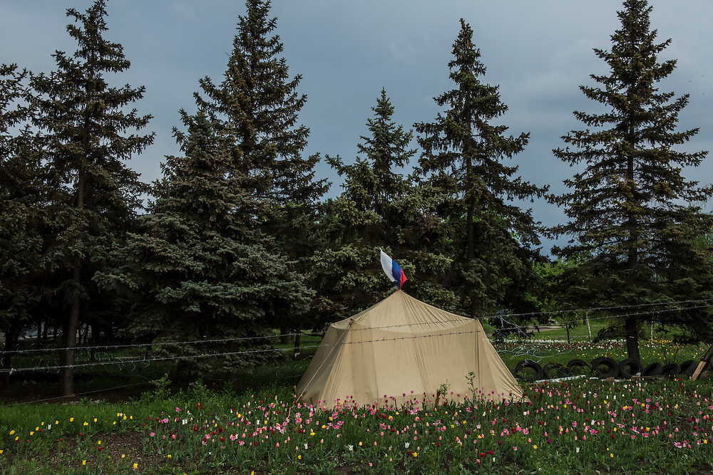 LUHANSK, UKRAINE - MAY 3: A tent topped with a Russian flag sits in a field of tulips at the edge of a pro-Russia encampment near the occupied security council building on May 3, 2014 in Lukansk, Ukraine. Cities across Eastern Ukraine have been overtaken by pro-Russian protesters in recent weeks, leading the Ukrainian military to respond with force in some areas. (Photo by Brendan Hoffman for The Washington Post)