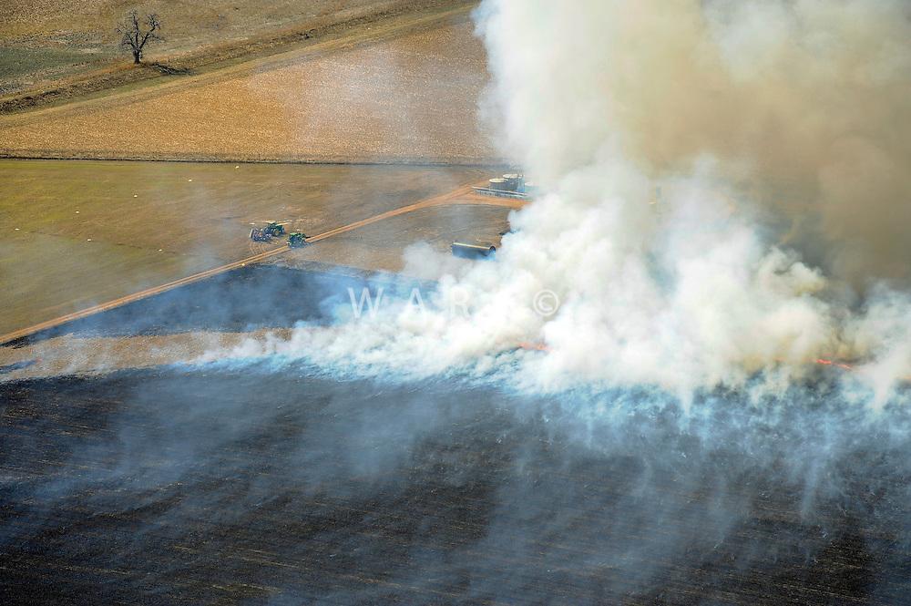 Burning crop field, near Longmont, Colorado. March 2010