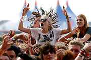 READING, ENGLAND - AUGUST 25:  Music fans soak up the atmopshere as Odd Future Wolf Gang Kill Them All (OFWGKTA) perform live on the Main Stage on Day Two during the Reading Festival 2012 at Richfield Avenue on August 25, 2012 in Reading, England.  (Photo by Simone Joyner/Getty Images)