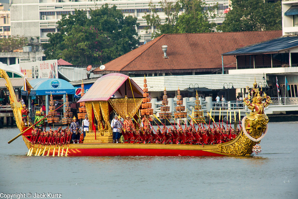 06 NOVEMBER 2012 - BANGKOK, THAILAND: The Royal Barge Narai Song Suban is propelled down the Chao Phraya River, rowed by 50 oarsmen in the dress rehearsal for the Royal Barge Procession. The Royal Barge Narai Song Suban was built by Rama IX, the current King of Thailand and is the newest addition to the Royal Barge fleet. Thailand's Royal Barge Procession has both religious and royal significance. The tradition is nearly 700 years old. The Royal Barge Procession takes place rarely, typically coinciding with only the most important cultural and religious events. During the reign of King Bhumibol Adulyadej, spanning over 60 years, the Procession has only occurred 16 times. The Royal Barge Procession consists of 52 barges: 51 historical Barges, and the Royal Barge, the Narai Song Suban, which King Rama IX built in 1994. It is the only Barge built during King Bhumibol's reign. These barges are manned by 2,082 oarsmen. The Procession proceeds down the Chao Phraya River, from the Wasukri Royal Landing Place in Bangkok, passes the Grand Palace complex and ends at Wat Arun. Tuesday's dress rehearsal was the final practice for the 2012 Royal Barge Procession, which takes place November 9.   PHOTO BY JACK KURTZ