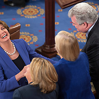 House Minority Leader Nancy Pelosi, left, shakes hands with other law makers chosen to judge the voting during the opening session of the 113th US House of Representatives in the U.S. Capitol in Washington, D.C., January 3, 2013. UPI/Ken Cedeno