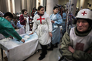 A medical team is shown with a field hospital set up in the lobby of the Ukraine Hotel off Maidan Square on February 20, 2014 in Kiev, Ukraine. Violent clashes intensified for a second day as Ukranian security forces fired live ammunition and at least 70 people died in the fighting, according to published reports quoting medical workers who were treating the victims.
