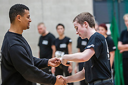Another P1 student receives his certificate from Franklyn Hartkamp at the Institute Of Krav Maga Scotland grading today at Stirling.<br /> &copy;Michael Schofield.