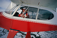 Still flying high at 93, Hal Wright, delivers copies of his newspaper, the Sierra Booster, to rural subscribers around Loyalton California from his plane.  Reporter, writer, editor and pilot, Wright is proof that birthdays are no reliable measure of the aging process.