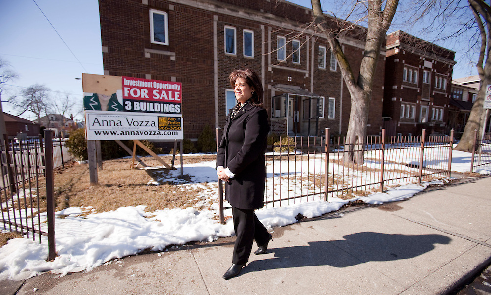 Windsor, Ontario ---10-02-19--- Anna Vozza, President of the Windsor/Essex Real Esate Board walks in front of an investment property consisting of 3 buildings close to downtown Windsor, February 18, 2010. The 3 properties have an asking price of $600,000. <br /> GEOFF ROBINS The Globe and Mail