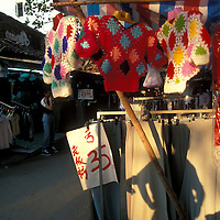 China, Jiangxi Province, Nanjing, Shadows on street market stall in Fuzi Miao district at sunset
