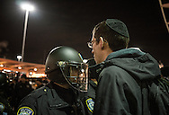 Protester confronts a police officer at the Anti-Trump rally at John F. Kennedy International Airport, after the Trump administration implemented a ban on entry to citizens of 7 Muslim-majority nations into the United States.  New York, New York, USA.  28 January 2017