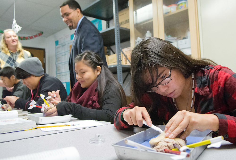 mkb121616b/metro/Marla Brose121616<br /> Amalia Pino, right, disects a sheep heart in her biology class at Walatowa High Charter School during a visit from U.S. Secretary of Education John King, who is finishing his farewell tour, Friday, Dec. 16, 2016, in Jemez Pueblo, N.M. (Marla Brose/Albuquerque Journal)