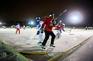 The Mad City Pond Hockey Championship was held January 24-26 at the Vilas Lagoon near Lake Wingra in Madison, Wisconsin. Photos from the first night matches Friday, Jan. 24, 2014