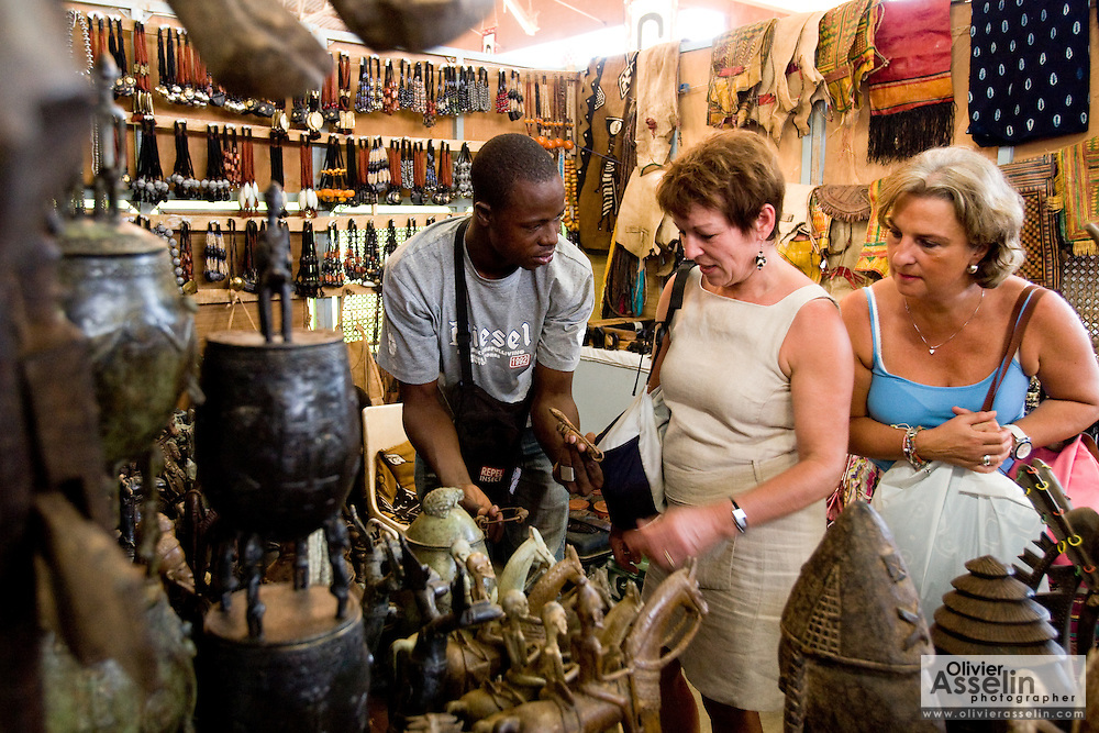 Customers look at handcrafts at the 22nd Salon International de l'Artisanat de Ouagadougou (SIAO) in Ouagadougou, Burkina Faso on Saturday November 1, 2008.