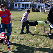 Tufts mentors from the DREAM program lead their students from the Somerville Housing Authority in races on the Tufts Residential Quad. (Kelvin Ma/Tufts University)