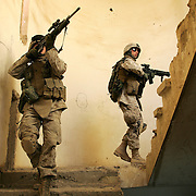 1 December 2004...Yusuiyah, Iraq...US Marines patrol Yusufiyah.....In an effort to crush the insurgent groups operating in North Babel province US Marines have set up Forward Operating Bases in the heart of enemy territory.....From these bases they are able to patrol the surrounding towns and countryside. Great efforts are being made to interact with the local Iraqi's.....As the area is a hotbed of anti-US activity great vigilance is required when entering buildings, they must be searched from top to bottom at gunpoint after which the soldiers must  remain on guard against snipers hiding in nearby houses or palm groves.......Hold for copy by John Burns slugged 'WAR'