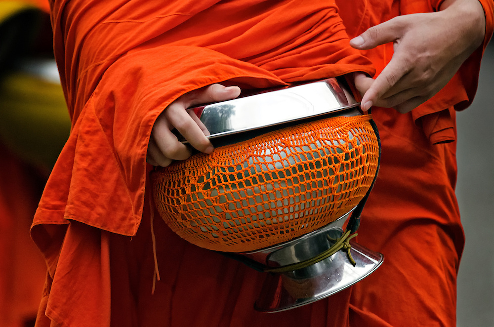 Novices collecting alms in Luang Prabang, Laos.