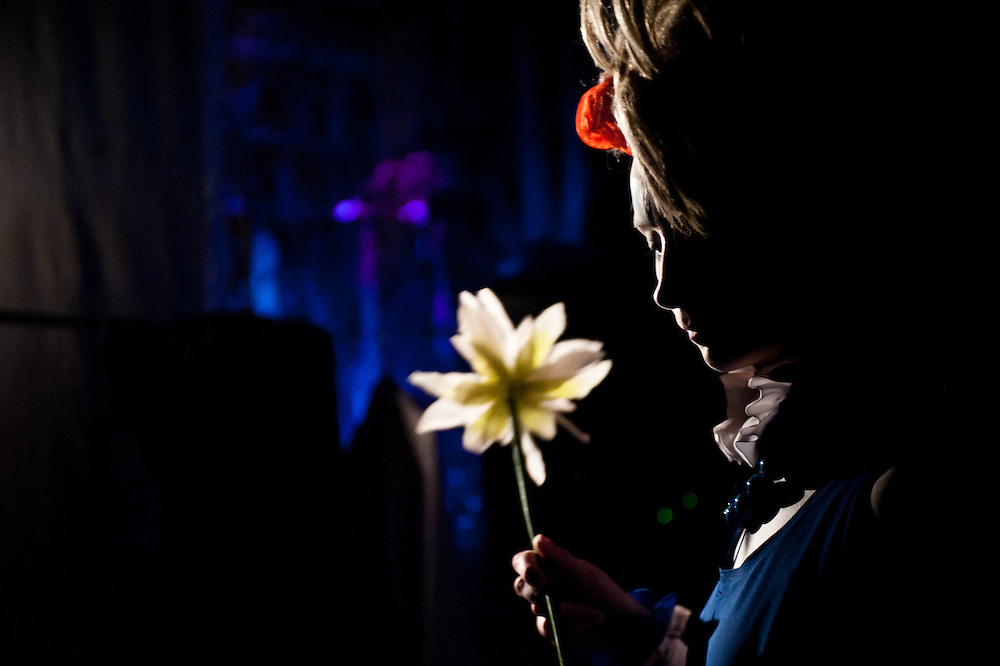 """London, UK - 3 November 2013: Ekaterina Voevodkina holds a flower in the dark backstage of The Moscow State Circus """"Park Gorkogo""""."""