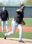 GLENDALE, AZ - FEBRUARY 24:  Shortstop Alexei Ramirez #10 of the Chicago White Sox throws batting practice during spring training workouts on February 24, 2015 at The Ballpark at Camelback Ranch in Glendale, Arizona. (Photo by Ron Vesely)   Subject:   Alexei Ramirez