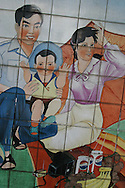 "A tiled mural in a Guangzhou street advocates ""happy families"", and China's ""one child"" policy for families, in a bid to control the growing population of the country."